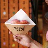 最近韓國SNS熱門打卡小吃!少女心十足的...粉紅色「愛心糖餅」你也想要試試看嗎?