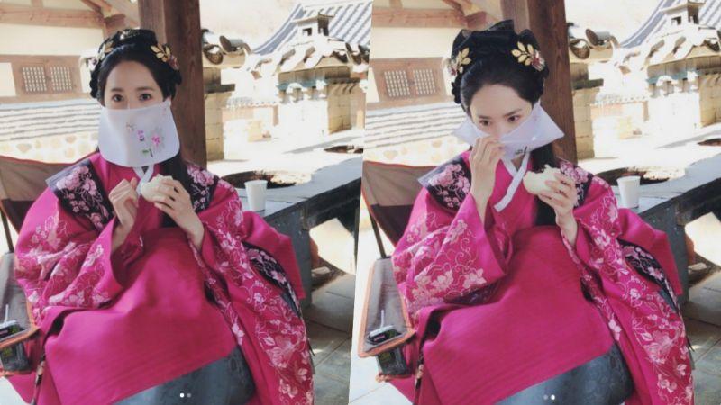 润娥穿古装酷似人偶 女神吃包子都是那么美