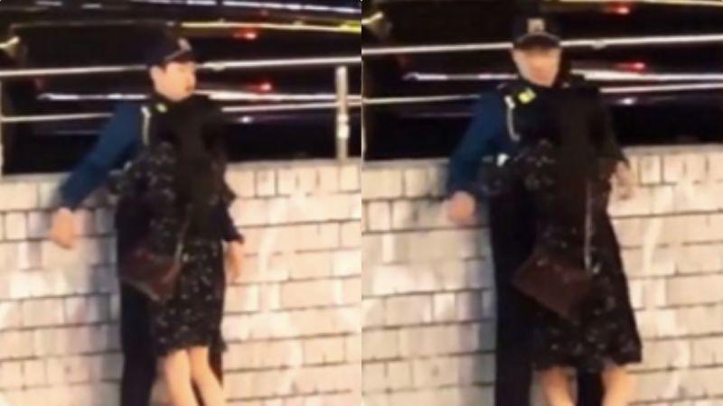 韩国警察惨遭醉酒女熊抱完全不敢动~双手张开坚决不碰:担心被骂性骚扰!
